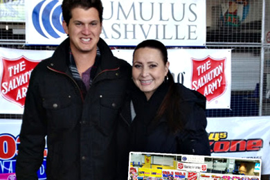Becca Walls (R) visited with Jon Pardi (L) at Nashville's LP Field when he stopped by to donate toys for Toy Field. Pardi's Capitol Nashville debut album, 'Write You A Song,' is planned for release January 14.