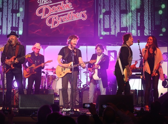 Pictured (l-r):  The Doobie Brothers' Patrick Simmons, Brad Paisley, the Doobies' Tom Johnston, Josh Leo, Doobie John McFee, and Sara Evans. Photo credit:  Alan Poizner