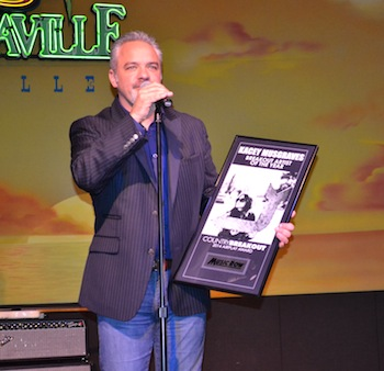 Damon Moberly accepts Kacey Musgraves' award for Breakout Artist.