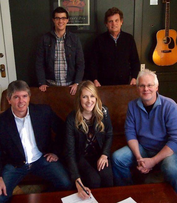 Pictured (seated, L-R): John Rolfe, Writer's Den attorney; Melissa Fuller;Bobby Rymer, Writer's Den partner. (standing, L-R) - Writer's Den writers Ben Cooper and Thom Schuyler.