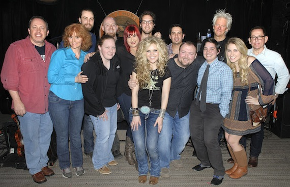 (L-R) WNOE's Don Gosselin and Mary Steele; the band's Joel Dormer; WNOE's Nina Hazard; the band's James Bavendam; WNOE's Jeanne LaCombe; the band's Zach Morse, Natalie Stovall and Miguel Cancino; WNOE's Brad Howell and Lindsey Luquette; HitShop President Skip Bishop; WNOE's Megan Parenti; and HitShop's Kim Stephens.
