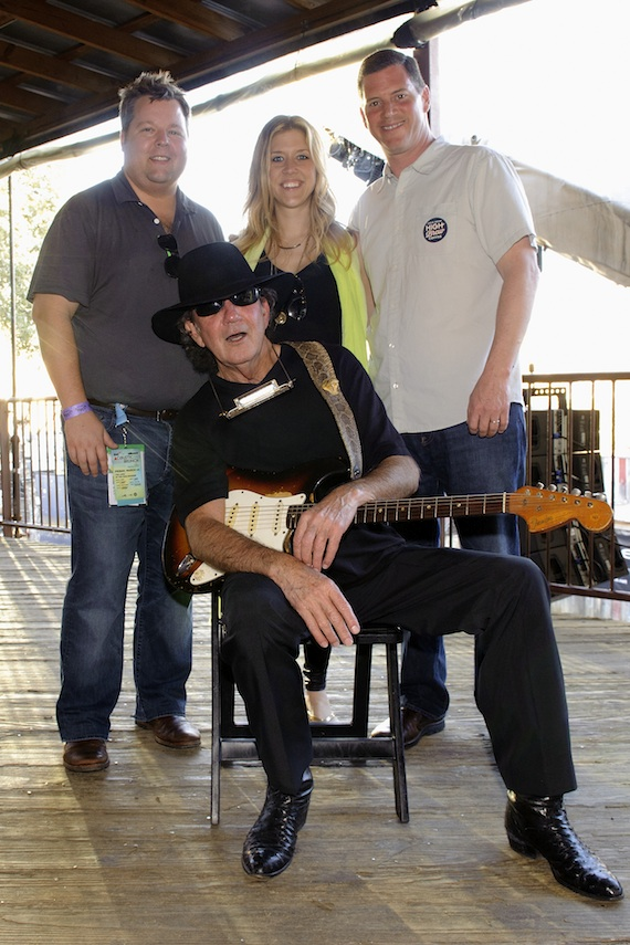 Pictured (L-R): BMI's Bradley Collins, Penny Everhard and Mark Mason pause for a photo with artist Tony Joe White (seated) at BMI's Howdy Texas party at Stubb's BBQ during SXSW on March 11, 2014, in Austin, TX. Photo: Erika Goldring.
