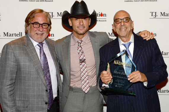 Creative Artist Agency's Rod Essig, Tim McGraw, and winner of the Spirit of Nashville Award Mark Bloom pose backstage, Photo: Rick Diamond/Getty Images