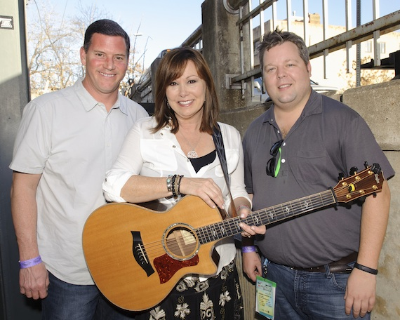 BMI's Mark Mason (l) and Bradley Collins (r) flank singer-songwriter Suzy Bogguss at BMI's Howdy Texas party at Stubb's BBQ during SXSW on March 11, 2014, in Austin, TX. Photo: Erika Goldring.