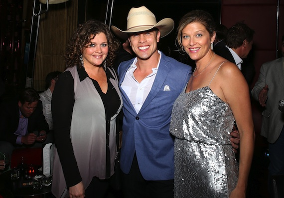 Pictured (L-R): Magic Mustang Publishing's Juli Newton Griffith with singer Dustin Lynch and SESAC's Shannan Hatch.