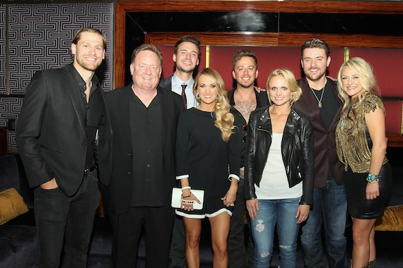 Chase Rice, Overton, Love and Theft's Eric Gunderson, Carrie Underwood, Love and Theft's Stephen Barker Liles, Miranda Lambert, Chris Young, and Leah Turner. Photo:  Meishach Moore / Christie's Photographic Solutions
