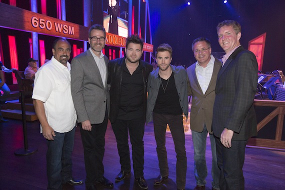Pictured side stage at the Grand Ole Opry (l-r):  Sony Music Nashville Marketing Sr VP Paul Barnabee; Opry Entertainment Group President Steve Buchanan; Zach and Colton Swon; Grand Ole Opry VP/GM Pete Fisher; and Hill Entertainment Group President Greg Hill. (photo 2 credit:  Chris Hollo)