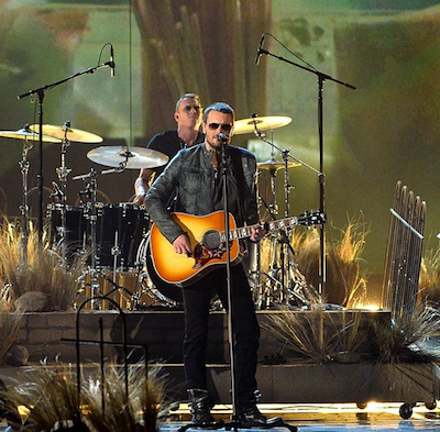 Dark songs require dark shades—Eric Church wants his hometown back.