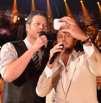 Selfie time! Co-hosts Luke Bryan and Blake Shelton search for the biggest stars in the room—decide they are the biggest stars.