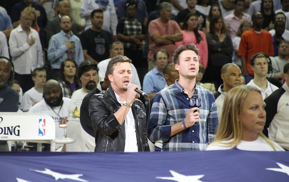 Love and Theft perform the national anthem.
