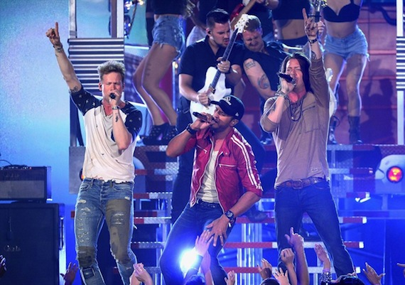 Luke Bryan and Florida Georgia Line perform at the Billboard Music Awards.