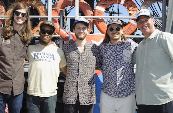 Nashville's The Lonely Biscuits join BMI's Mark Mason backstage at the 2014 Hangout Music Festival.