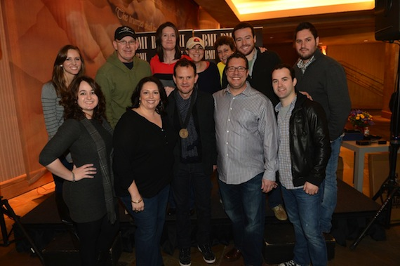Verges and his UMPG team in 2013: Top row (L-R): Amanda Merki, Executive Assistant to Kent Earls, UMPG Nashville; Ron Stuve, VP of A&R/Special Projects, UMPG Nashville; Whitney Williams, Creative Director, UMPG Nashville; Missy Wilson, Senior Creative Director, UMPG; Tammy Helm, Manager of Administration, UMPG Nashville; Travis Gordon, Creative Manager, UMPG Nashville; Freeman Wizer, Creative Director, UMPG NashvilleBottom row (L-R): Kendall Connell, Receptionist, UMPG Nashville; Cyndi Forman, Vice President, Creative, UMPG Nashville; Troy Verges; Kent Earls, Executive Vice President/General Manager, UMPG Nashville; John Mark Capers, Catalog and Studio Manager, UMPG Nashville