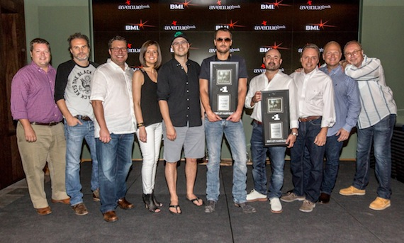 "BMI hosted a celebration honoring Eric Church's most recent #1 hit single ""Give Me Back My Hometown"" amongst music industry VIPs at their Nashville office yesterday afternoon. Co-written by Church and Luke Laird, ""Give Me Back My Hometown"" is from Church's critically acclaimed fourth studio album, The Outsiders, which debuted at #1 on Billboard's Top 200 and Top Country Albums charts. The song is the fifteenth #1 hit for BMI's 2012 Songwriter of the Year Luke Laird, and the third #1 for Eric Church. Pictured (l-r): BMI's Bradley Collins, Q Prime's John Peets, Songs of Universal's Kent Earls, Creative Nation's Beth Laird, Luke Laird, Eric Church, Longer and Louder Music's Arturo Buenahora, BMI's Jody Williams, Sony / ATV Tree Publishing's Troy Tomlinson, Universal Music Group's Mike Dungan. Photo credit: Ed Rode"