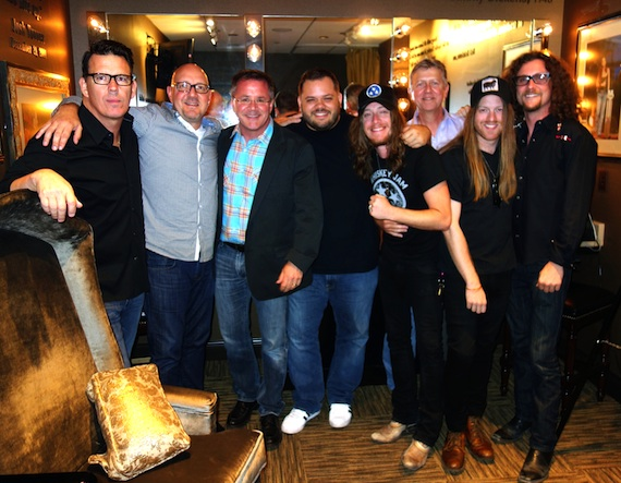 Pictured (L-R): Big Machine Records' Erik Powell, Jack Purcell, The Opry's Pete Fisher, WSIX's Michael Bryan, The Cadillac Three's Jaren Johnston, Jaren's father Jerry Johnston, Neil Mason and Kelby Ray.
