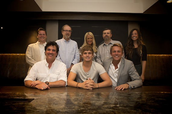 Pictured (L-R): Back Row – Iconic Entertainment's Brian O'Neil, BMLG's Malcolm Mimms, Allison Jones, Andrew Kautz & Iconic Entertainment's Ally Rodriguez Front Row – BMLG's Scott Borchetta, Levi Hummon & Iconic Entertainment's Fletcher Foster. Photo: Seth Hellman for The Valory Music Co.
