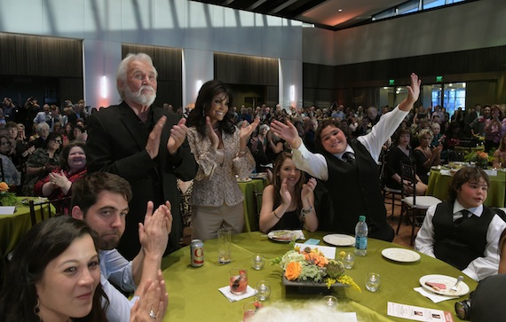 "Rogers and family members react to songwriter Don Schlitz's performance of the hit ""The Gambler."""