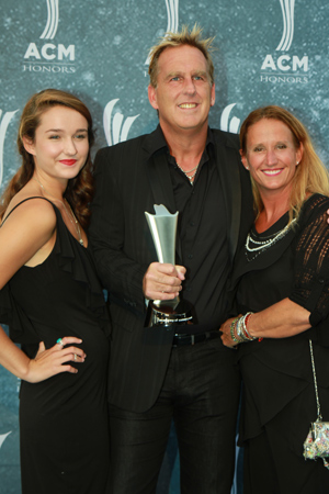 Brian O'Connell (c) with family, presented his sixth Promoter of the Year statuette. Photo: Bev Moser.