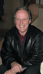 Dr. E Michael Harrington