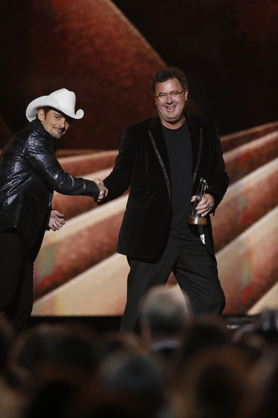 "Brad Paisley presents Vince Gill with the Irving Waugh Award of Excellence during ""The 48th Annual CMA Awards."" Photo: John Russell / CMA"