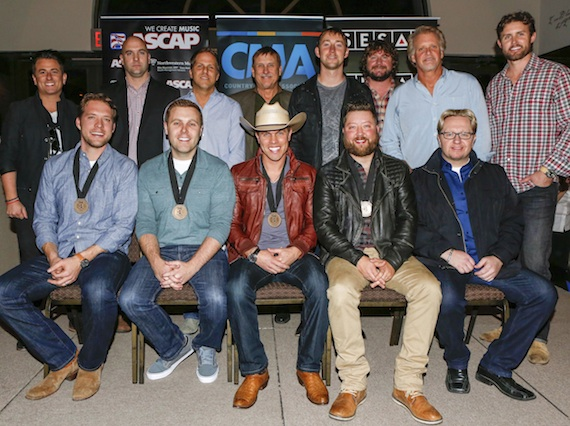 Pictured (L-R, front row): ASCAP co-writers Matt Jenkins and Zach Crowell, Dustin Lynch, SESAC co-writer Cary Barlowe, producer Mickey Jack Cones. (back row): Major Bob Music's Jesse Frasure, ASCAP's Robert Filhart, Broken Bow's Jon Loba, SESAC's John Mullins, Tape Room Music's Ashley Gorley, Combustion Music's Chris Van Belkom and Chris Farren, and Warner/Chappell Music Publishing's Ryan Beuschel. Photo: Ed Rode.