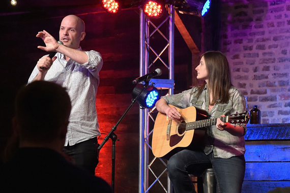 YouTube personality Todd Womack (L) introduces a performance from Erin Enderlin (R). Photo: Rick Diamond