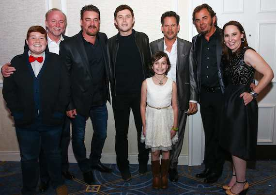 Pictured (L-R): Thomas (a Make-A-Wish child); Joey Hemphill, Chairman & Treasurer, Hemphill Brothers Coach Company and Make-A-Wish Board Member;  Rob Beckham, Co-Head, WME Nashville and Make-A-Wish Board member; Scotty McCreery; Jessica (a Make-A-Wish child); Gary Allan; Jonathan Cain; and Beth Torres, President & CEO, Make-A-Wish Middle Tennessee.