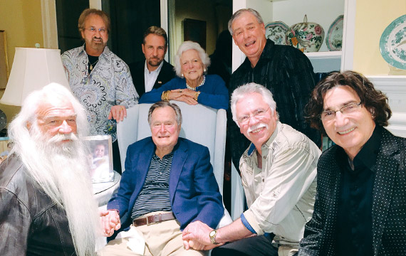 Pictured (L-R) front: William Lee Golden, President George H.W. Bush, Joe Bonsall and Richard Sterban. Standing: Duane Allen, Darrick Kinslow, Barbara Bush & Darrell Bowling).