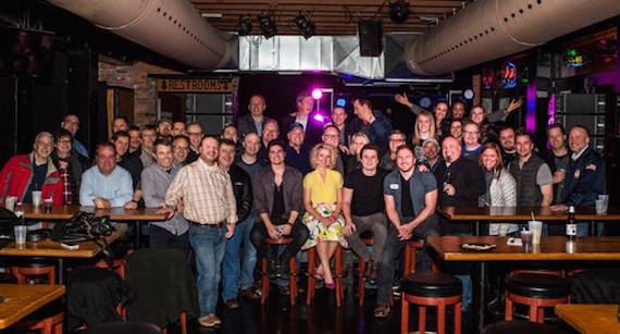 (Seated, L-R): Columbia Nashville's Steven Lee Olsen, Arista Nashville's Cam, Columbia Nashville's Josh Dorr and Arista Nashville's Logan Mize;  (in the midst of the crowd) Clay Hunnicutt, Executive Vice President of National Programming Platforms, iHeartMedia; Sony Music Nashville'sChairman & CEO Gary Overton; Keith Gale, SVP, Promotion, RCA Nashville; Lesly Simon, VP, Promotion, Arista Nashville; and, Norbert Nix, VP, Columbia Nashville.