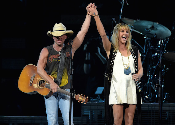 Grace Potter joins Kenny Chesney onstage in Nashville. Photo: Rick Diamond/Getty Images