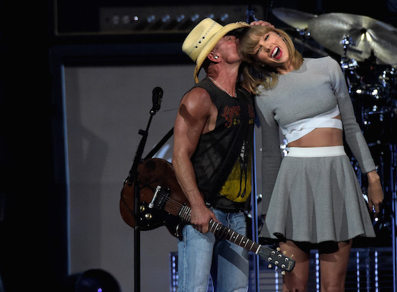 Kenny Chesney welcomes Taylor Swift during his Nashville concert. Photo: Rick Diamond/Getty Images