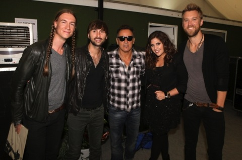 In July 2012 Lady Antebellum took a break from the European leg of their headlining world tour to open for Bruce Springsteen in London's Hyde Park. (L-R): Jason Gambill (guitar, Lady Antebellum), Dave Haywood, Bruce Springsteen, Hillary Scott and Charles Kelley. Photo: Adam Boatman