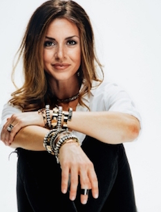 Shelly Brown wearing designs from her jewelry collection.