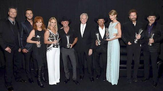 ACM co-hosts Blake Shelton and Luke Bryan, with Milestone Award winners Reba, Miranda Lambert, Kenny Chesney, trophy/ jewelry designer David Yurman, George Strait, Taylor Swift and Brooks & Dunn.