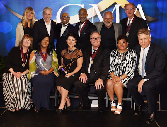 Pictured (L-R, back row): Shelley and Louie Giglio, Bishop Paul S. Morton, BeBe Winans, Al Andrews, Roland Lundy, Twila Paris, CeCe Winans, Candy Christmas, Mark Lowry, Jackie Patillo and John Huie. Photo: Getty Images