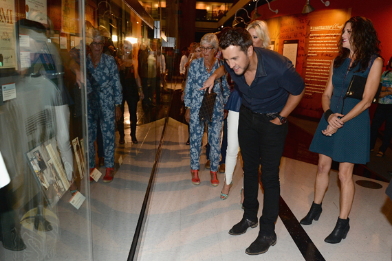 Luke sees his exhibit for the first time with his mother in the background and manager Keri Edwards behind. Photo: Jason Davis/Getty Images for CMHOF