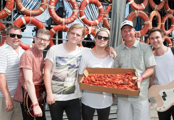 Colony House 44: Showing off their backstage food options, BMI songwriters and Nashville-based indie rockers Colony House stands with BMI's Bradley Collins (far left) and Mark Mason (far right) at the BMI Stage at Hangout Music Festival.