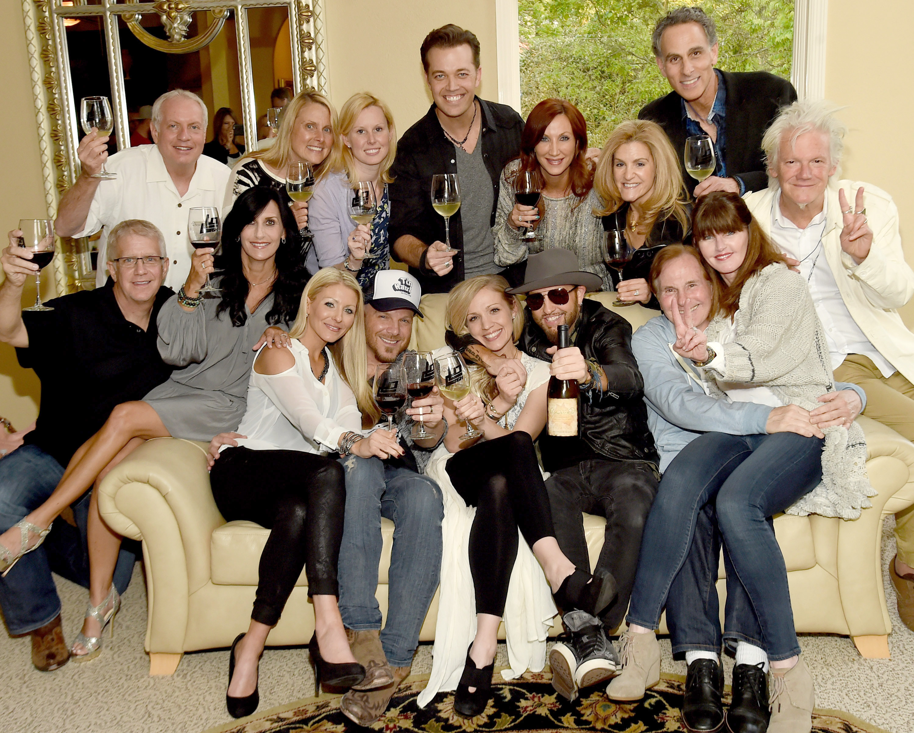Pictured (L-R), Lower front row: Kaitlyn Lucas, Chris Lucas (LOCASH), Kristen White, Preston Brust (LOCASH), Butch Waugh, Belinda Waugh, Skip Bishop. Middle: Jon Ozor (Stonum Vineyards), Rhonda Ozor Top row Ken Little, Julie Little, Kelly Ziegenfuss (Reviver), Lucas Hoge (Reviver artist), Laura Lynn, Jennifer Ross, David Ross (Reviver).