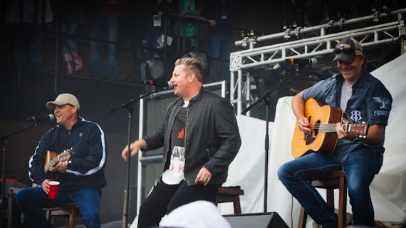 Rascal Flatts' Gary LeVox (middle) performs on stage with songwriters, Neil Thrasher (left) and Kelley Lovelace (right) during Sunday night's performance at Tree Town Music Festival in Forest City, Iowa. (PRNewsFoto/Songs for Sound)