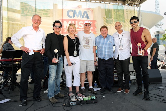 At CMA World GlobaLive! trophies were present to event host Morgan Evans, who received the CMA Global Country Artist Award, and CMA Board member and CEO of Big Machine Label Group Scott Borchetta, who received the Jo Walker-Meador International Award. (L-R): Frank Bumstead, Chairman Flood Bumstead McCready & McCarthy, Inc. and CMA Board Chairman; Scott Borchetta; Sarah Trahern, CMA Chief Executive Officer; Rob Potts, CEO and Manager Director of Rob Potts Entertainment Edge, and CMA International Committee Vice Chairman; Jeff Walker, CEO/Founder of AristoMedia, CMA World GlobaLive! Executive Producer, and CMA Board member; David Ross, President of BossRoss Media and CMA Board member; and Morgan Evans. Photo: John Russell / CMA