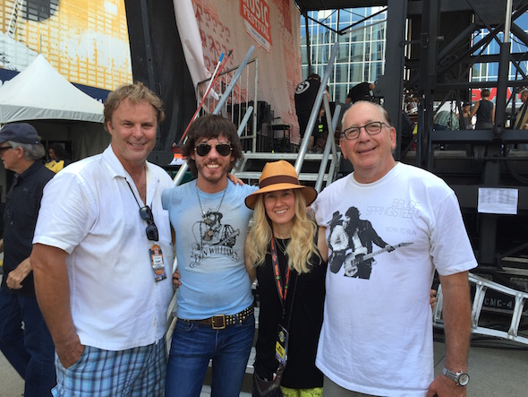 Pictured: (L-R): Warner Music Nashville EVP of A&R Scott Hendricks; Janson; WMN VP of A&R Cris Lacy and WMN president & CEO John Esposito
