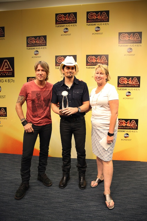 Brad Paisley receives the CMA International Artist Achievement Award backstage at the CMA Music Festival during a press conference at the Nightly Concert Sunday at LP Field. (L-R) Keith Urban, CMA Foundation National Ambassador; Paisley; and Sarah Trahern, CMA Chief Executive Officer. Photo: Hunter Berry / CMA
