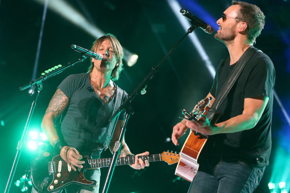 "Eric Church joined Keith Urban for a performance of their No. 1 song ""Raise 'Em Up"" during Sunday night's concert at LP Field during the 2015 CMA Music Festival. Photo : John Russell/CMA"