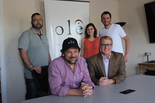 Pictured (L-R:) Randall Foster (ole, Sr. Director, Creative Licensing), Emily Mueller (ole, Creative Manager), and Ben Strain (ole, Creative Director). Front, from left: ole songwriter Marty Dodson and John Ozier (ole, GM Creative)