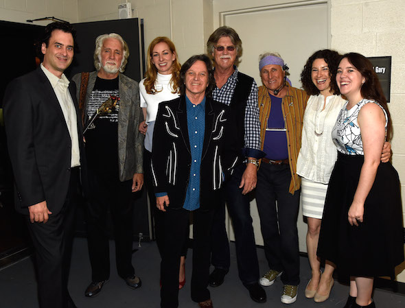 Pictured backstage at the CMA Theater are (L-R): The Country Music Hall of Fame and Museum's Peter Cooper; The Nitty Gritty Dirt Band's John McEuen; The Country Music Hall of Fame and Museum's Lisa Purcell; The Nitty Gritty Dirt Band's Jeff Hanna, Bob Carpenter, and Jimmie Fadden; and The Country Music Hall of Fame and Museum's Abi Tapia and Amanda Richards.   Photo Credit: Rick Diamond, Getty Images for the Country Music Hall of Fame and Museum