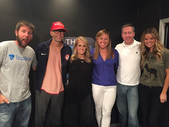 Pictured (L-R): Bobby Bones Show co-host Lunchbox; host Bobby Bones; Carrie; Lesly Simon, VP, Promotion, Arista Nashville; Justin Cole, Director of Country Programming, Premiere Networks and co-host Amy.