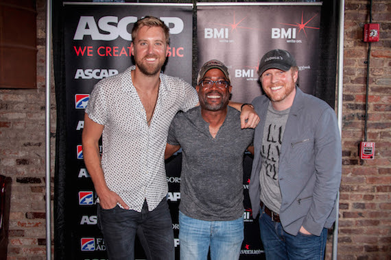 "(Pictured, L-R): Charles Kelley, Darius Rucker and Nathan Chapman celebrate Rucker's No. 1 hit, ""Homegrown Honey."" Photo: Ed Rode"