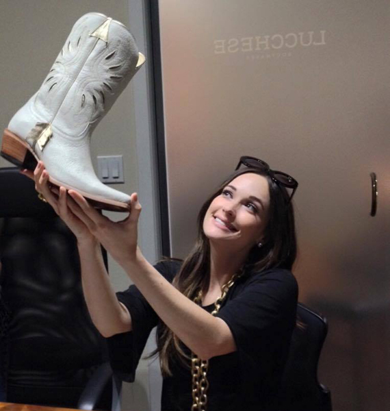 Kacey Musgraves eyes samples of her Kacey for Lucchese line on July 29. Photo: Facebook.