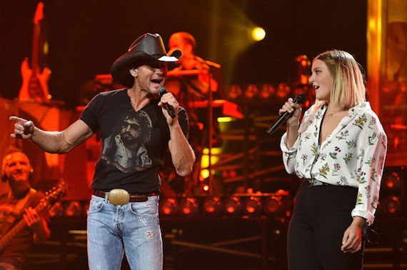 Tim McGraw performs with daughter Gracie.