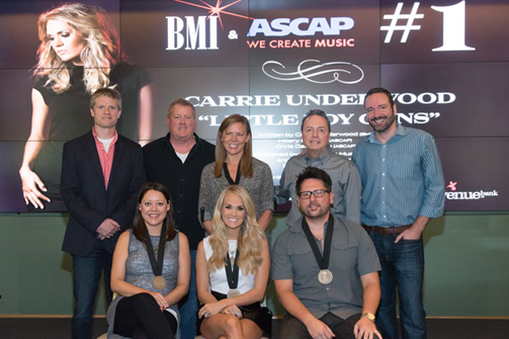 (L-R) (back row): BMG's Kos Weaver, ASCAP's Mike Sistad, Arista's Lesly Tyson, BMI's Jody Williams, Sony ATV's Josh Van Valkenburg. (Front row): ASCAP songwriter Hillary Lindsey, BMI singer-songwriter Carrie Underwood and ASCAP songwriter Chris DeStefano.